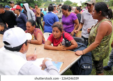 Matias Romero, Oaxaca / Mexico - Nov. 10, 2018: A Salvadoran woman fleeing poverty and gang violence in the third caravan to the U.S. registers with the local Catholic diocese at a sports field.