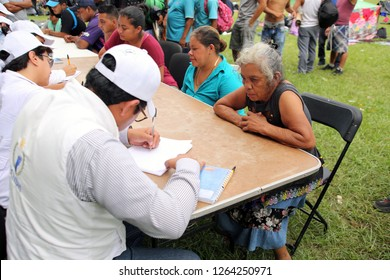 Matias Romero, Oaxaca / Mexico - Nov. 10, 2018: An older Salvadoran woman fleeing poverty and gang violence in the third caravan to the U.S. registers with the local Catholic diocese.
