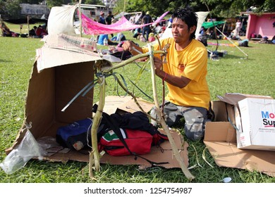 Matias Romero, Oaxaca/Mexico - Nov. 10, 2018: A Salvadoran man fleeing poverty and gang violence in the third caravan to the U.S. builds a personal shelter in a field from found materials.