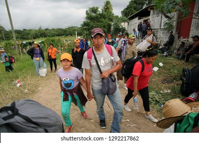 Matias Romero, Oaxaca/Mexico - Nov. 10, 2018: A Salvadoran family fleeing poverty and gang violence in the third caravan to the U.S. walks to wait for trucks to take them to their next stop.