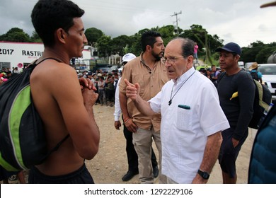 Matias Romero, Oaxaca/Mexico - Nov. 10, 2018: The local Catholic priest who arranged trucks for Salvadorans fleeing poverty and gang violence in the third caravan to the U.S. speaks with one of them.