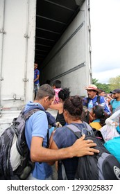 Matias Romero, Oaxaca/Mexico - Nov. 10, 2018: A Salvadoran couple fleeing poverty and gang violence in the third caravan to the U.S. wait to board a truck to take them to their next stop.