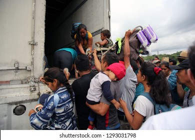 Matias Romero, Oaxaca/Mexico - Nov. 10, 2018:  A Salvadoran family fleeing poverty and gang violence in the third caravan to the U.S. board a truck to take them to their next stop in Veracruz.