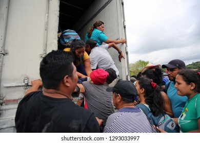 Matias Romero, Oaxaca/Mexico - Nov. 10, 2018: Salvadorans fleeing poverty and gang violence in the third caravan to the U.S. board a truck to take them to their next stop in Veracruz.