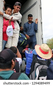 Matias Romero, Oaxaca/Mexico - Nov. 10, 2018: A Salvadoran couple fleeing poverty and gang violence in the third caravan to the U.S. boards a truck to take them to their next stop in Veracruz.