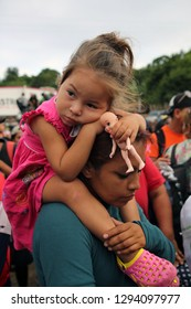 Matias Romero, Oaxaca/Mexico - Nov. 10, 2018: A Salvadoran mother and daughter fleeing poverty and gang violence in the third caravan to the U.S. wait to board a truck to take them to their next stop.