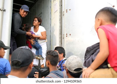 Matias Romero, Oaxaca/Mexico - Nov. 10, 2018: A Salvadoran family fleeing poverty and gang violence in the third caravan to the U.S. boards a truck to take them to their next stop in Veracruz.