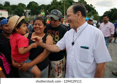 Matias Romero, Oaxaca/Mexico - Nov. 10, 2018: The local Catholic priest who arranged trucks for Salvadorans fleeing poverty and gang violence in the third caravan to the U.S. speaks with a child.