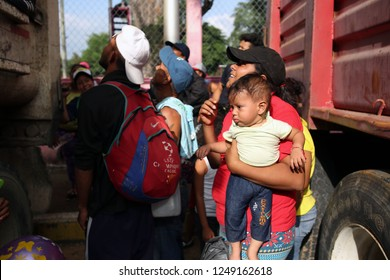 Matias Romero, Oaxaca/Mexico - Nov. 8, 2018: A Honduran woman fleeing poverty and gang violence in the second caravan to the U.S. holds her son while waiting for other family to climb off a truck.