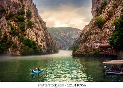 Matka, Macedonia - August 26, 2018: Canyon Matka near Skopje, with people kayaking and magical foggy scenery with calm water