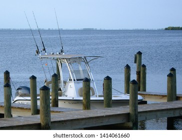 MATLACHA, FLORIDA - , October 18, 2015: A Key West brand center console fishing boat is tied up to a slip and is ready for a fishing trip with rods and reels/