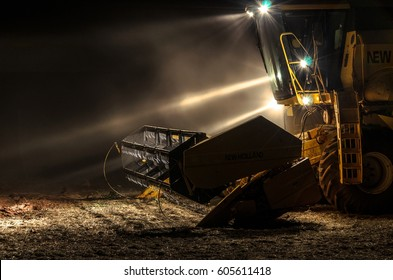 MATO GROSSO DO SUL, BRAZIL - FEBRUARY 28, 2017: New Holland TC57 tractor parked with lights turned on at night after the soybean harvest season on farm.