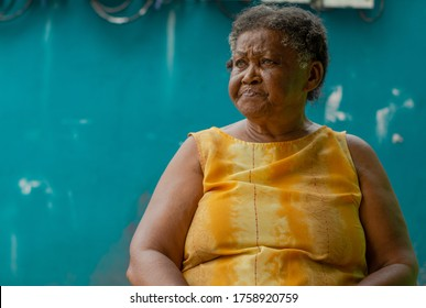 mator lady looking homeless indigenous, smoked with sad face and blue eyes