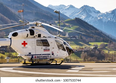 MATREI, AUSTRIA - MARCH 28: Red Cross medic MD Helicopter MD Explorer by McDonnell Douglas Helicopter Systems stands on heliport on 28 March 2012 in Matrei, Austria.