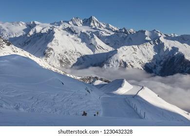 Matrei in Osttirol, Grossglockner Resort, Austria. Snowy ski slope. Mountains in the background.