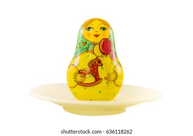 Matryoshka doll; Russian doll, in a bowl isolated on the white background