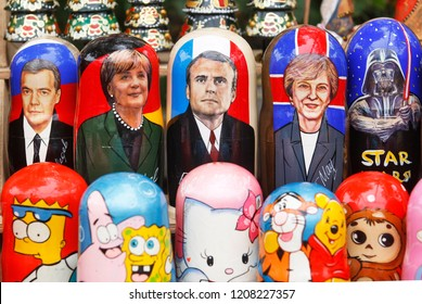 Matryoshka dolls with faces Dmitry Medvedev,Angela Merkel,Emmanuel Macron,Theresa May and Darth Vader (L-R) on a street's souvenirs vendor in Kiev, Ukraine, 20 October 2018