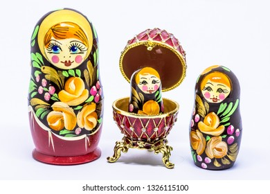 Matryoshka family. Matrioska art Russian doll and Russian souvenir, egg casket copy  on a White background