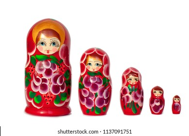 Matryoshka Russian doll souvenir in group bright red on white background isolated closeup
