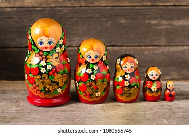 Matryoshka. Russian folk toys. On wooden background.