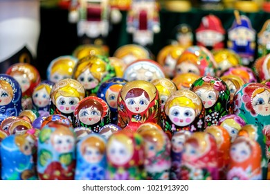 A lot of Matryoshka at souvenir market shop. Different colors Russian dolls. Traditional classic Russian handicraft art background. Famous classical and modern Russian dolls Matryoshka toys