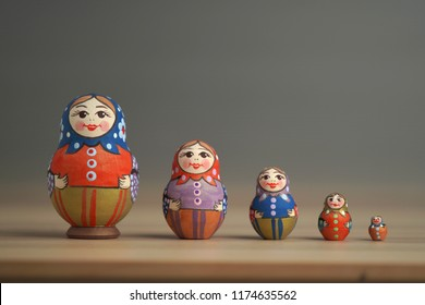 Matryoshka traditional Russia dolls are on the table.