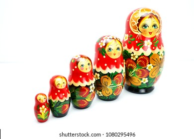 Matryoshka traditional Russian wooden dolls,Russian souvenir Matrioshka ,Nesting dolls single too soft and blurry on white  background bring in richly and wealthy.