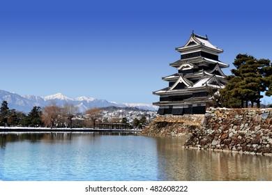 Matsumoto castle (aka Crow Castle) in front of Japanese Alps, Matsumoto, Nagano, Japan
