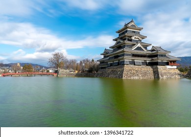 Matsumoto Castle (or Matsumoto-jo) with its moat in Matsumoto, Nagano prefecture, Japan. It is also known as the Crow Castle (Karasu-jo) due to its black exterior.