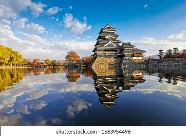 Matsumoto Castle with its reflection in autumn, Matsumoto, Nagano Prefecture, Japan on morning.   - Shutterstock ID 1563954496