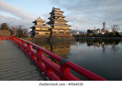 Matsumoto castle, view from the bridge overlooking Matsumoto castle with the city in background