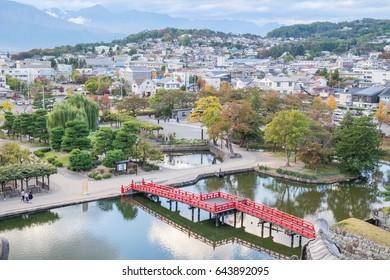 Matsumoto city view with beautiful red wooden bridge from Matsumoto Castle, Nagano, Japan