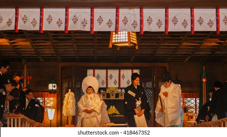 MATSUMOTO, JAPAN - NOVEMBER 21, 2015: Unidentified Japanese groom and bride attend a Japanese traditional wedding ceremony at Yohashira shrine
