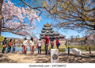 Matsumoto ,Nagano, Japan - April 20, 2019 :  People visiting Matsumoto castle on Cherry Blossom full bloom in Matsumoto  , Nagano Prefecture, Japan.