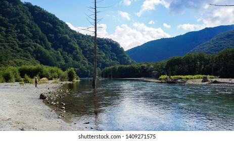 MATSUMOTO, NAGANO PREFECTURE, JAPAN - SEPTEMBER 14, 2014: Kamikochi, also known as the Japan Alps from Chubu Sangaku National Park, enchants visitors with its majestic nature scenery.