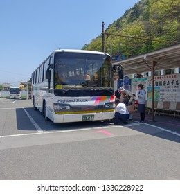 Matsumoto, Nagano Prefecture/Japan- April 2016:  Passengers boarding shuttle bus used to transport tourists into the Chubu Sangaku National Park. (no personal vehicles are allowed).