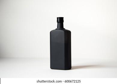 Matt black spirit bottle isolated