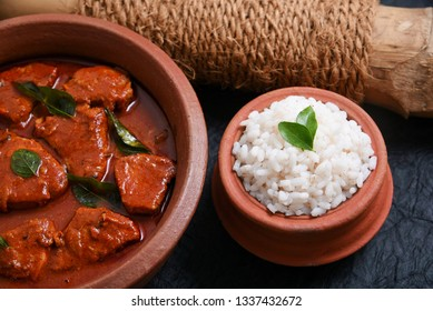 Matta rice and Kerala red fish curry is a hot and spicy seafood cuisine masala gravy Alappuzha India. cooked with ingredients curry leaves, kokkum and coconut milk. a popular dish  in coastal area.