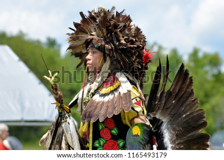 MATTAPONI RESERVATION, VIRGINIA – May 25, 2014: A Native American dancer participates in traditional dances at an annual Pow Wow gathering.