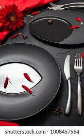 Matte plate on black background with red accent color. Restaurant table layout for fancy dinner concept
