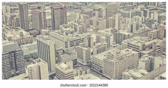 Matte vintage. Skyscrapers in the city. City life. Amazing urban landscape from aerial view. Awesome photo of Megalopolis. City Business District. Pastel tone. Beautiful background