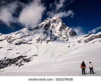Matterhorn from Cervinia side with two lone skiiers