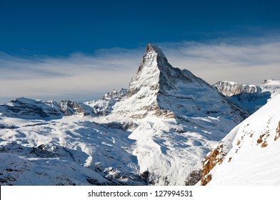 Matterhorn is a mountain in the Pennine Alps on the border between Switzerland and Italy. Its summit is 4,478 meters high. The Matterhorn has become an iconic emblem of the Swiss Alps.
