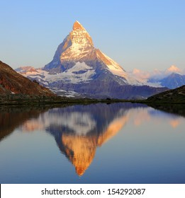 Matterhorn peak with reflection on Riffelsee, Switzerland