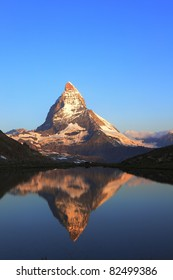 Matterhorn peak and reflection on Riffelsee, Switzerland