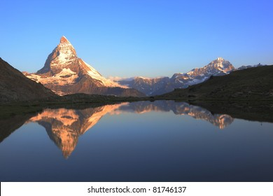 The Matterhorn peak and reflections on the Riffelsee in early morning