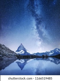 Matterhorn and reflection on the water surface at the night time. Milky way above Matterhorn, Switzerland. Beautiful natural landscape in the Switzerland