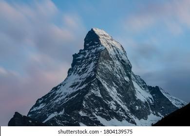 Matterhorn summit beautiful view long exposure shot at sunset with scenic colorful clear sky taken from Zermatt in Swiss Alps Switzerland