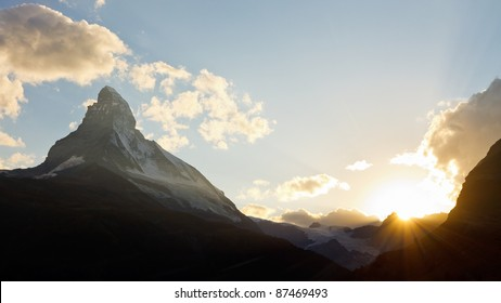 Matterhorn at sunset. The sun is setting behind Switzerland's most iconic mountain.
