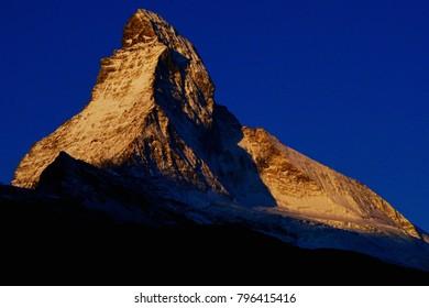 Matterhorn in Zermatt in the evening colors before sunset, brilliant dark blue sky